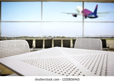 Desk of free space and airport interior background