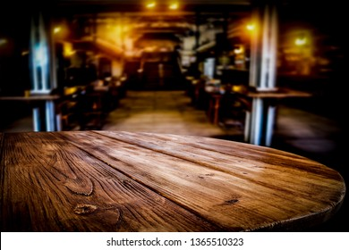 Desk of free space and blurred background of bar