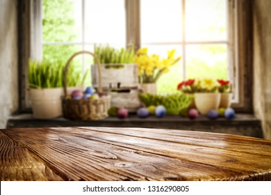 Desk of free space and Easter time. Blurred background of window space