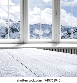 desk with free space and white window of winter