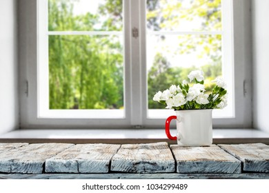 Desk of free space with window and few spring flowers