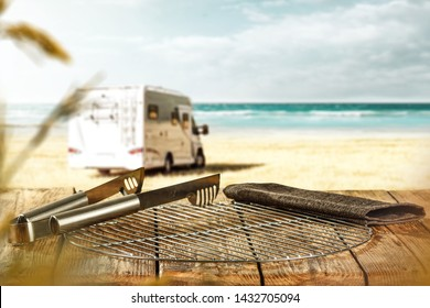 Desk of free space for your decoration and summer grill time on beach. Sea landscape with sky and sumer car.