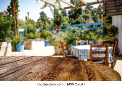 Desk of free space for your decoration and summer blurred background of garden.