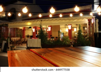Desk of free space for your decoration and background of summer bar  with lamps