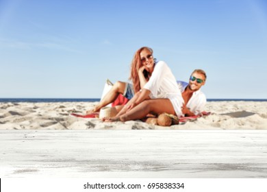 desk of free space for your decoration and background of two lovers on beach