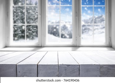 Desk of free space for your decoration. Winter window with landscape and snow .