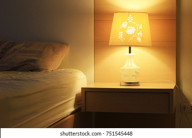 desk lamp of hotel bedroom interior.