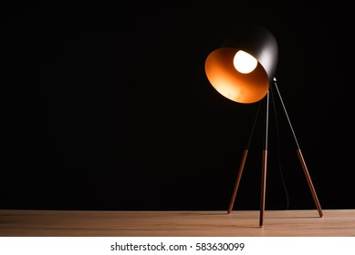 Desk lamp on empty wooden office table as space for text or product placement