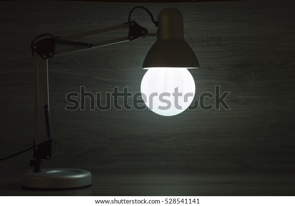 desk lamp on the table illuminating the room