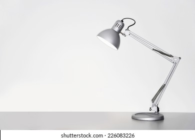Desk lamp on table over white background