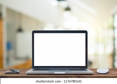 Desk Laptop with blank screen on table of coffee shop blur background with bokeh,Front view of cup