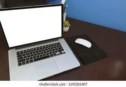 Desk Laptop blank text space screen in office on wood table. Lap