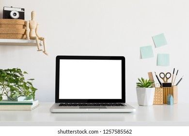 Desk with laptop for mock up or product montage. Stylish workspace.