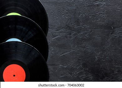 Desk of musician or dj with vynil records for songwriter work on dark background top view mockup