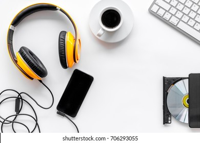 Desk of musician for songwriter work with headphones and smartphone on white background top view mockup