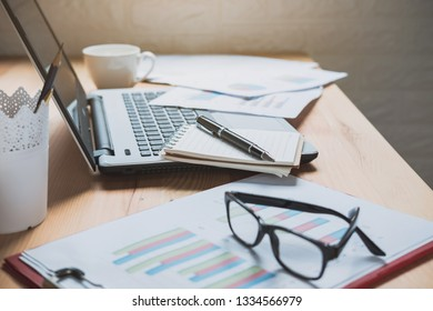 Desk office with marketing graph statistics analysis