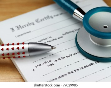 A doctor's desk showing a teal stethoscope, doctors pen and sick certificate pad.