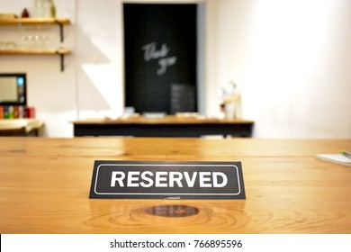 "Desk Sign ""Reserved"" place on the wooden dining table"