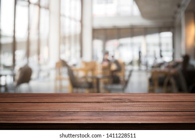 Desk space and blurry background of cafe coffee shop for product display montage