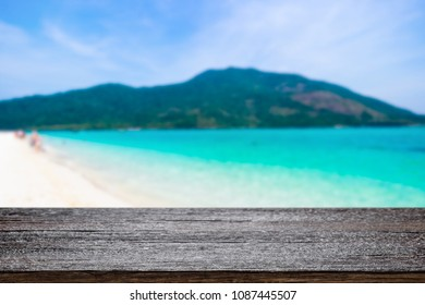 Desk space over summer sea side sunny day background. Product display montage