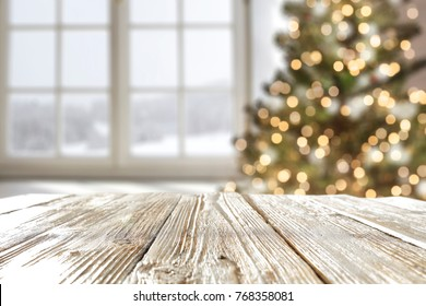 desk space and window with christmas tree