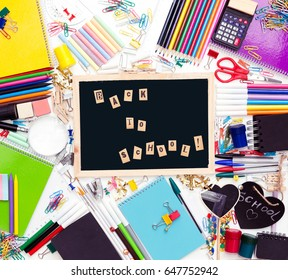 Desk with stationary and with Back to school sign