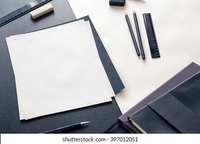 Desk with stationery and A4 blank paper