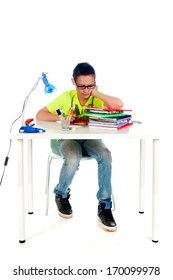 a desk for a teenager to make homework. Desk with books, exercise books, lamp; pen, pencils and a chair.