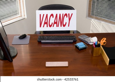 Desk with a Vacancy sign.  Your text in the blank name plate.  Great for employment/HR/unemployment themes.