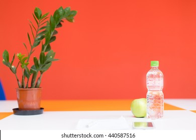 desk water bottle plant sheet paper
