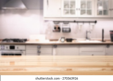 desk of wooden top and kitchen place