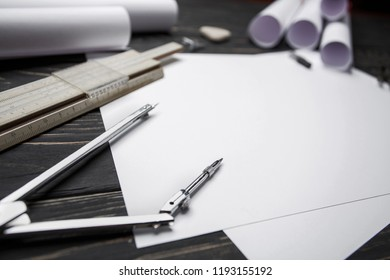 Desktop for the architect. Learn to draw circles with a compass. Building drawings on the table at the architect. selective focus