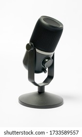 Desktop black microphone on white background