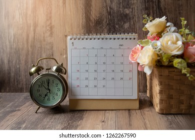 Desktop Calendar 2020 place on wooden office desk.Calender and clock for Planner timetable,agenda appointment,organization,management each date,month,year on office, table.Calendar Background Concept.