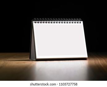 desktop calendar on the wooden table