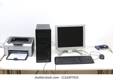 Desktop computer with display keyboard mouse and printer on desk