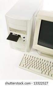 Desktop Computer and floppy Disk close up shot