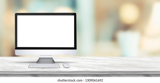 Desktop computer mock up on marble table and blurred soft light table in luxury restaurant with bokeh background. product display template.Business presentation