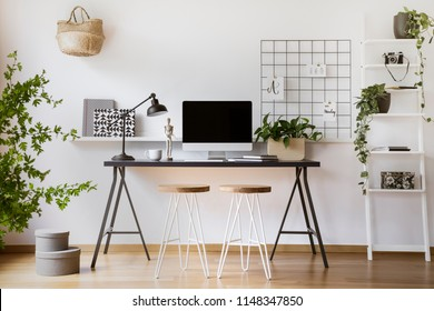 Desktop computer mock-up on an industrial desk in a scandinavian student bedroom interior workspace with white walls