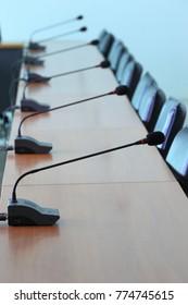 Desktop microphone on meeting table