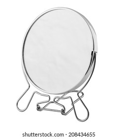 desktop mirror in a metal frame on a white background