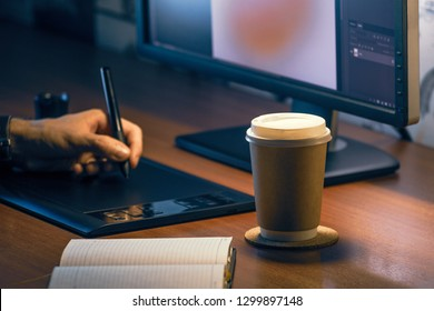 Desktop side view. Computer Graphics Tablet Diary Cup of coffee Hand. Concept for website banner, mockup, background, presentation and marketing material