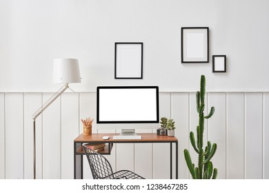 Desktop wooden table and frame with lamp vase of cactus white background.