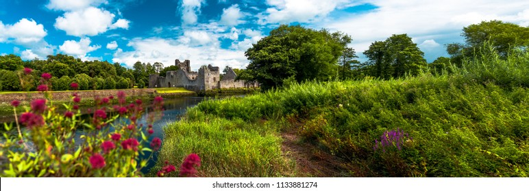 The Desmond Castle in Adare beautifull Village, on the banks of the Maigue River, in Ireland, Co. Limerick.