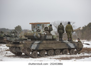 DESNA, CHERNIHIV OBLAST, UKRAINE - FEBRUARY, 13, 2015: Reserve officers from the fourth wave of the draft in Ukraine take part in military training in 169 Training Center of the Land Forces
