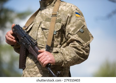 DESNA, CHERNIHIV OBLAST, UKRAINE - MAY, 18, 2015: Newly enlisted soldiers take part in military training at the 169 Training Center of the Land Forces in Desna following the 5th round of mobilization