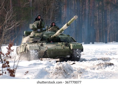 Desna, Ukraine - February 23, 2013.  The  T-64BM Bulat tank in the winter snow-covered wood.