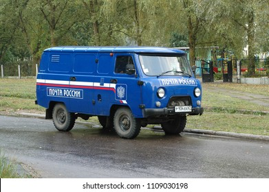 DESNOGORSK, RUSSIA - AUGUST 21, 2008: russian post delivery 4x4 van UAZ at work. It was very popular delivery vehicle in russian countryside in early 2000s.