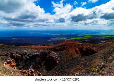 A desolate aerial scene from above of  Sierra Negra volcano, a volcanic environment located in Isabela island, Galapagos, Ecuador