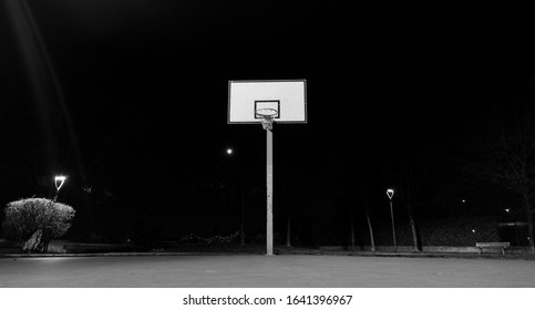 Desolate Basketball court in the night in a park